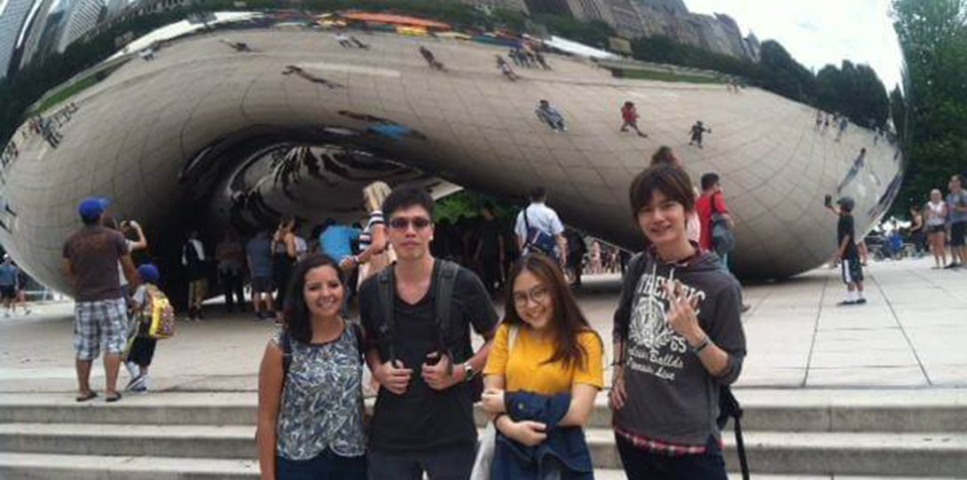 Students posing in front of the Bean