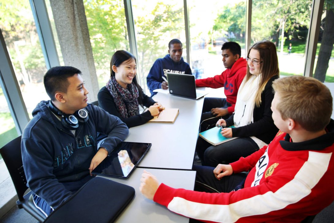 Students working together around a table