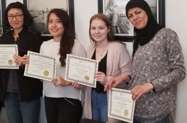 students holding certificates of program completion