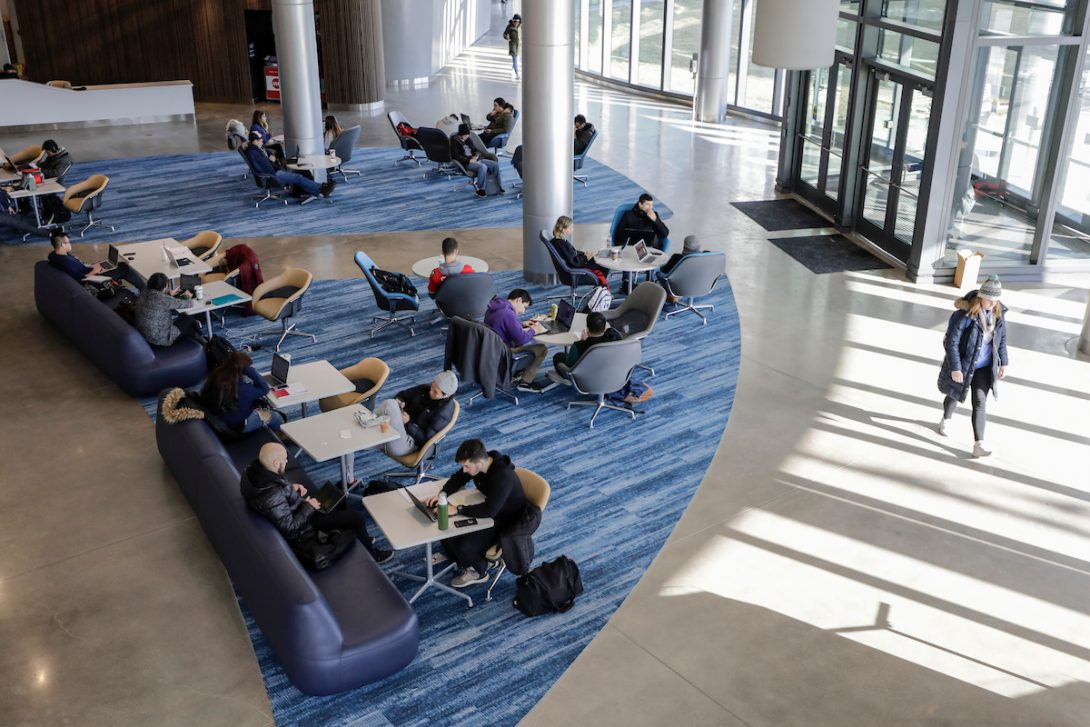students studying in campus building