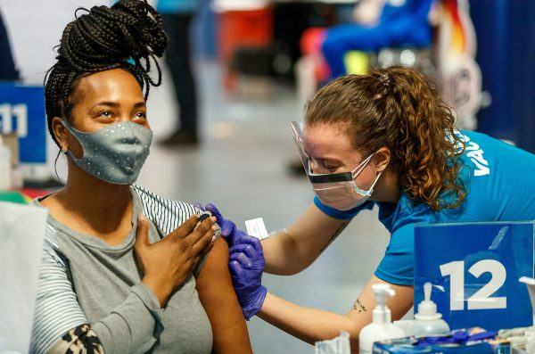 student receiving vaccination