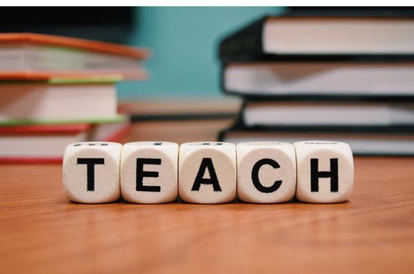 Letters spelling TEACH